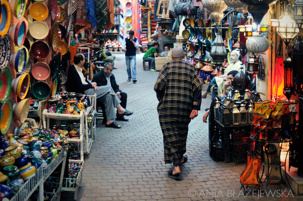 Morocco, Marrakesh. Man walking the street of the souk.
