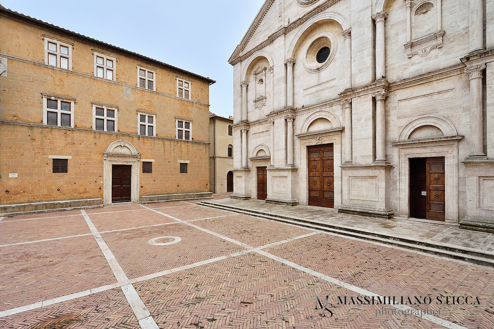 Palazzo Vescovile, on the third side of the piazza, was built to house the bishops who would travel to Pienza to attend the pope. Its construction was financed by Cardinal Rodrigo Borgia (the future Pope Alexander VI but, at the time, Vatican Vice-Chancellor). It may represent a remodeling of the old town hall of Corsignano. It is now home to the Diocesan Museum, and the Museo della Cattedrale. The collection includes local textile work as well as religious artifacts. Paintings include a 12th-century painted crucifix from the Abbey of San Pietro in Vollore, 14th century works by Pietro Lorenzetti (Madonna with Child) and Bartolo di Fredi (Madonna della Misericordia). There are also important works from the 14th and 15th centuries, including a Madonna attributed to Luca Signorelli.