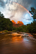 Rainbow over Cathedral Rock at Red Rock Crossing and Oak Creek, in Sedona, Arizona.