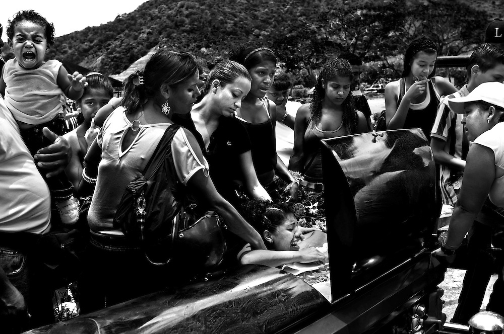 Relatives mourned Yanil Cemeno during his funeral. He was his mother's fourth son to be murdered in the slums of Caracas, Venezuela.