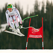 SHOT 12/2/11 12:45:19 PM - Austrian skiier Klaus Kroell takes flight off the Red Tail jump during the downhill on The Birds of Prey course at the Audi FIS World Cup on December 2, 2011 in Beaver Creek, Co. Kroell finished third in the race. (Photo by Marc Piscotty / © 2011)