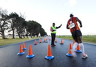 CAPE TOWN, SOUTH AFRICA - OCTOBER 10: Bruce Mpela, walking official, gives Stephen Msimago of CGA, a warning during the South African Race Walking Championship at Youngsfield Military Base on October 10, 2015 in Cape Town, South Africa. (Photo by Roger Sedres/ImageSA)
