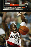 Blazers' Ruben Patterson (21) slams the ball with authority. The Blazers defeated the Mavericks 125-103.