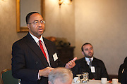 Gerald St. Claire, guest, asks question of the panelists. The Manhattan Chamber of Commerce Annual Economic Outlook Breakfast was held at the New York Athletic Club in New York on April 4, 2011. The breakfast was sponsored by Wells Fargo.