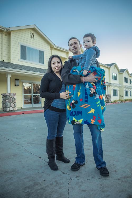 Rose Maldonado and Adrian Vergara with their son, Jonathan, near their home on Washington Street in Calistoga