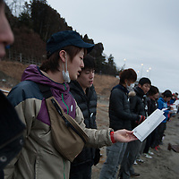"Students from across Japan form a line and hold hands at dawn, as participants in the Project HumanBand which attempted to form an unbroken line of participants along the tsunami-devastated coastline of north east Japan, and sing the well-known Japanese love song, Furusato"", for their homeland, on the 1 year anniversary of the March 11th 2011 magnitude 9 earthquake and subsequent tsunami, in Minami-Sanriku, Tohoku region,  Japan on Sunday 11th March 2012."