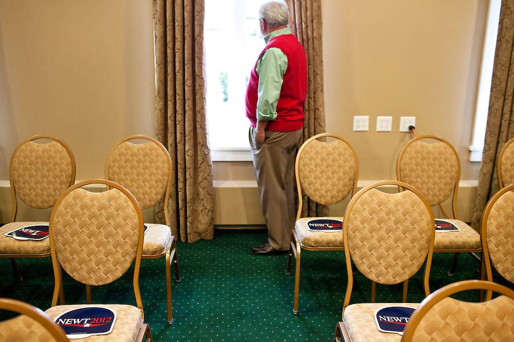 A man looks out the window waiting for Republican presidential candidate Newt Gingrich to arrive at a Rotary Club meeting on Tuesday, December 27, 2011 in Dubuque, IA.