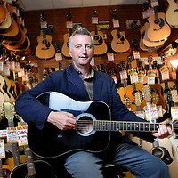 UK. London. Singer/songwriter and political activist Billy Bragg who is working with prisoners through his Jail Guitar Doors Charity. Photographed in Charring Cross and at Hank's guitar shop..Photo©Steve Forrest/Workers' Photos