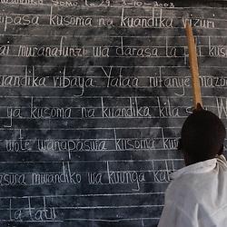Shinyanga, Tanzania, October 4, 2003: Children study at Waleza Primary school  October 04, 2003 in Shinyanga District, Tanzania. (Photo by Ami Vitale)