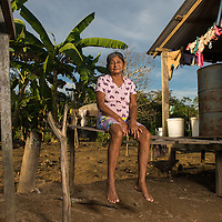 Ermoza Arce de Assumtao, 66, from the Xuraruema Community, poses for a photograph as other members of her community see doctors aboard Igaraçu Saturday June 20, 2015. The Igaraçu is a boat outfitted with medical and dental facilities. Doctors and nurses from the Igaraçu visit homes in the indigenous communities on tributaries of the Amazon river. Photo Ken Cedeno