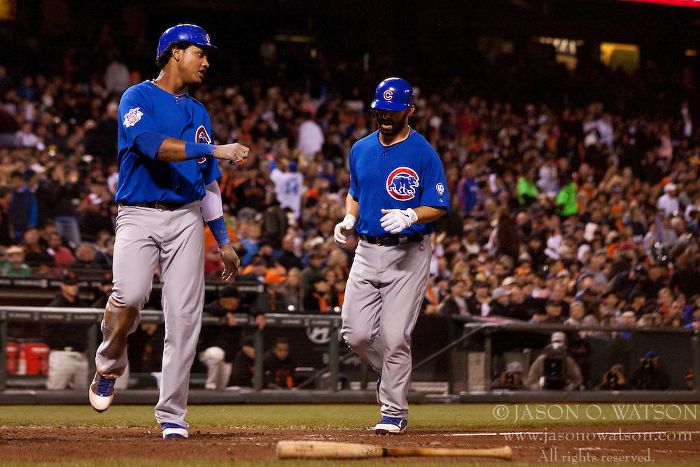 August 29, 2011; San Francisco, CA, USA;  Chicago Cubs left fielder Blake DeWitt (right) rounds the bases behind shortstop Starlin Castro (left) after hitting a three run home run against the San Francisco Giants during the seventh inning at AT&T Park.