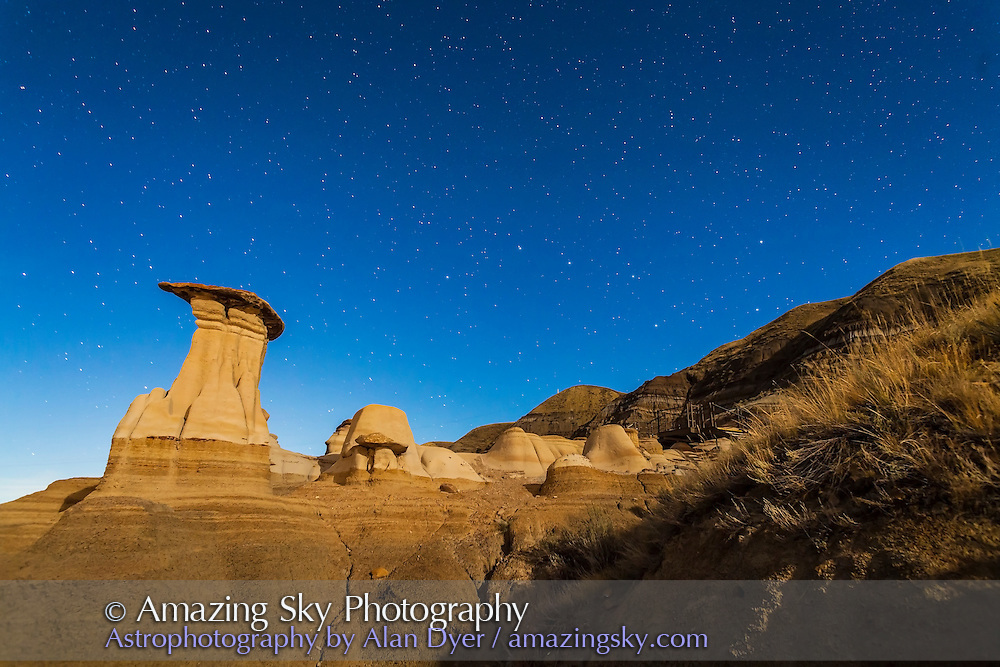 The Hoodoos in the Red Deer River valley on Highway 10 east of Drumheller. Taken September 21, 2013 with the Canon 5D MkII and 24mm lens with a single 30-second exposure. Light from waning gibbous Moon provided the illumination.