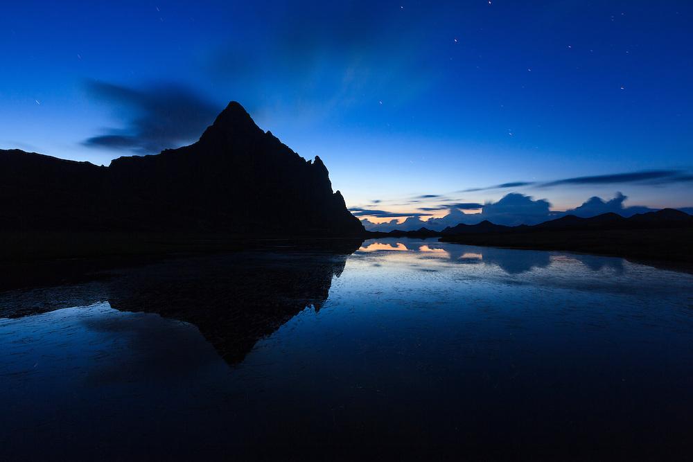 Anayet Peak at dusk, reflected on Ibon de Anayet (Anayet Lake). Pyrenees. Huesca province. Aragon. Spain.