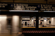Commuters waiting for the A train at the Atlantic Ave stop in Brooklyn, NY on June 23, 2012.