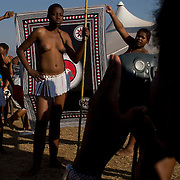 Young girls pose for their portraits at the Zulu royal palace in Nongoma, KwaZulu Natal, South Africa Sept 8, 2007. Thousands of virgin girls attend the annual Reed Dance at the Enyokeni palace from which the Zulu King Zwelethini may choose a bride. Photo Greg Marinovich / Bloomberg News