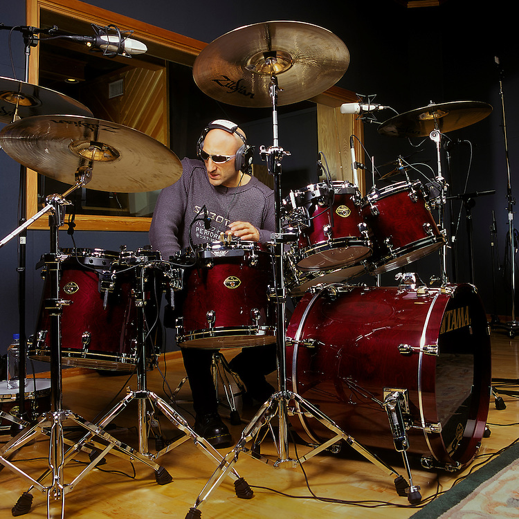 """Kenny Aronoff, world renowed drummer for his """"back-beat"""", recording tracks in Studio.  Musicians like John Mellencamp, Smashing Pumpkins, Bob Seger, John Fogerty, Melissa Etheridge, Jon Bon Jovi, and Elton John, to name only a few, seek out Kenny's talent on the drums for their albums. The Aronoff Percussion Scholarship is awarded annually to a percussion student enrolled at Indiana University where he used to be an Associate Professor of Percussion."""