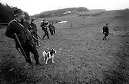 Farmers line up on the field for the next hunting place in the countryside of the Danish island Funen on sunday  17. November 2002.  Photo: Erik Luntang