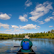 Canoeing to a new fishing spot in the Boundary Waters in Northern, Minnesota.