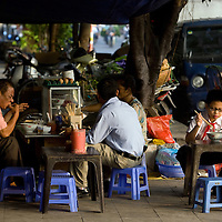 breakfast curbside in hanoi, vietnam