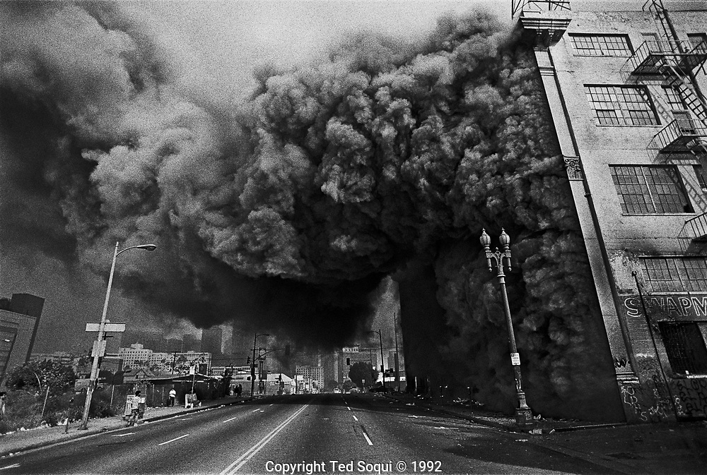 A swap meet malls burns on Pico Blvd.and 7th Street.<br /> <br /> Photography by Ted Soqui &copy; 1992 <br /> <br /> Los Angeles has undergone several days of rioting due to the acquittal of the LAPD officers who beat Rodney King.<br /> Hundreds of businesses were burned to the ground and over 55 people have been killed.