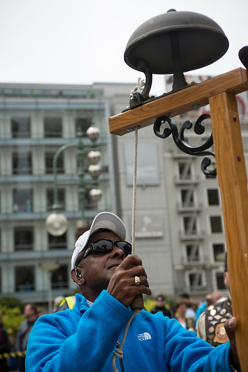 Ten time Cable Car Bell Ringing Champion Carl Payen (1977, 1978, 1980, 1981, 1983, 1984, 1987, 1988, 1989) tests out the bell before the 50th Cable Car Bell Ringing Competition in San Francisco's Union Square | July 11, 2013