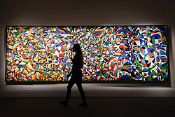 "© Licensed to London News Pictures. 21/04/2017. London, UK.  A staff member walks in front of ""Towards a Sky"", 1953, by Fahrelnissa Zeid (Est. GBP 550-650k), at a preview at Sotheby's, New Bond Street, of upcoming sales of Arts of the Islamic World, 20th century Middle East Art and Orientalist art. Photo credit : Stephen Chung/LNP"