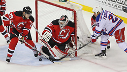 May 25, 2012; Newark, NJ, USA; New Jersey Devils goalie Martin Brodeur (30) makes a save on New York Rangers left wing Ruslan Fedotenko (26) during the first period in game six of the 2012 Eastern Conference finals at the Prudential Center.
