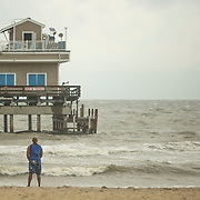 NORFOLK, VA - JULY 4: Russell Worrell, of NYC, watches the waves from Hurricane Arthur near the Ocean View Pier as the storm leaves Hampton Roads on Friday, July 4th, 2014 in Norfolk, Va. (Photo by Jay Westcott/For The Virginian-Pilot)