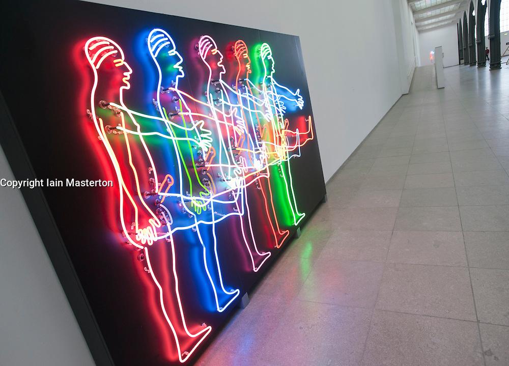 Light installation sculpture by Bruce Nauman titled Five Marching Men at Hamburger Bahnhof Museum of Contemporary Art in Berlin Germany