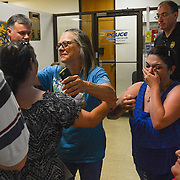 Murder victim Joshua Dewayne Davis' family reacts tot the news that capital murder charges had been filed against four suspects in his death. Davis' mother Renee Davis (back to the camera) is hugged by Debbie Halls while Davis' sister April Davis cries with joy.