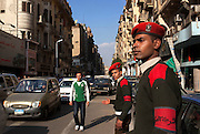 Egyptian military police help direct traffic in Talat Harb square February 12, 2011 in downtown Cairo, Egypt. The day after the revolution toppled the regime of President Hosni Mubarak, Egyptians continued to celebrate and began to focus on rebuilding their city and society. (Photo by Scott Nelson)