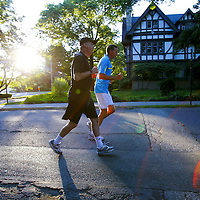 Ron Shaich, co-chief executive of Panera Bread, (L) begins his morning workout with personal trainer and friend Alex Ponomarenko (R) by jogging around Shaich's neighborhood in Brookline, Massachusetts on July 10, 2012.  Shaich has been working with Ponomarenko for going on six years and the two often find themselves chatting about politics and life during the morning workouts which last for an hour.  CREDIT: Matthew Healey for The Wall Street Journal.       WORKOUT- Shaich