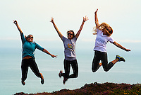 Three Fall 2012 Semester at Sea Students in Mid-Air During a Hike at Howth Head in Ireland. Image taken with a Nikon 1 V1 camera and 30-110 mm VR lens (ISO 100, 77 mm, f/10, 1/125 sec).
