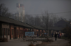 A view of Dongtan Village with the chimneys spewing smoke from nearby Jinhuarun Chemical Industry plant seen in the background in Zekou Town, Qianjiang City of Hubei Province, China 15 January 2013. While the heavy smog in Beijing and much of northern China in recent days have caused alarm among residents and renewed scrutiny on the pollution woes of the country, villagers in a small town of Hubei Province have been grappling with severe air, water and noise pollution on a daily basis over the past two years. China's Xinhua news reported 04 January 2013 that more than 60 cancer deaths in various villages of Zekou Town has been caused by the heavy pollution from the chemical industry park nearby. About 20 or more chemical plants built around the villages of Dongtan, Xiangnan, Zhoutan, Sunguai, Qingnian and others over the past two years has created huge increases in noise, air and water pollution. Many villagers complained of intensifying respiratory, heart, skin and circulatory illnesses caused by the pollution and a large spike in cancer diagnoses and deaths since the factories were built. .