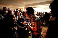 Carmen Soo (Philippines) signs an autograph for a fan at the 37th International Emmy Awards Gala in New York on Monday, November 23, 2009.  ***EXCLUSIVE***