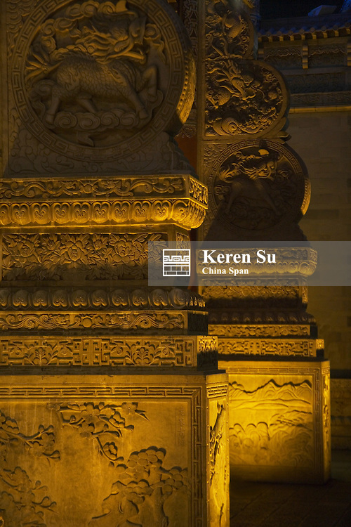 Architectural details on Golden Horse, Green Rooster (Jinmabiji) Memorial Arch, night view, Kunming, Yunnan, China