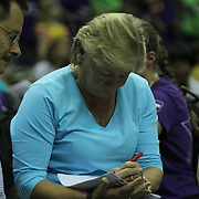 North Carolina Tar Heels women's head basketball coach SYLVIA HATCHELL is seen signing autographs during post game celebrations as the Washington Mystics defeated the Chicago Sky 82-78 Wednesday, July. 24, 2013 at The Verizon center in Washington DC.