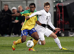 Solomon Islands' Leslie Nate and New Zealand's Michael McGlinchey tussle for the ball in a FIFA World Cup Qualifier Match, North Harbour Stadium, Auckland, New Zealand, Tuesday, September 11, 2012.  Credit:SNPA / David Rowland