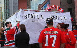 June 2; Newark, NJ, USA; Fans sign a banner before game 2 of the 2012 Stanley Cup Finals Game 2 at the Prudential Center.
