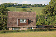 Tiled chalet bungalow house near Charlton Kings in Gloucestershire, England.