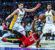 Los Angeles Lakers guard Nick Young (0) looks on as his teammate Jeremy Lin (17) and Houston Rockets guard James Harden (13) battle for a loose ball during their NBA game at Staples Center in Los Angeles, California on January 25, 2015 . Rockets defeated Lakers 99-87.