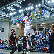 Delaware 87ers Forward Victor Rudd (23) drives towards the basket as Sioux Falls Skyforce Center Khem Birch (24) defends in the first half of a NBA D-league regular season basketball game between the Delaware 87ers (76ers) and the Sioux Falls Skyforce (Miami Heat) Tuesday, Dec. 2, 2014 at The Bob Carpenter Sports Convocation Center in Newark, DEL