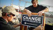 COLUMBIA, SC - DECEMBER 9: Stage hands Chris Herbert, left, and Fitz Rutherford place a placard on the podium before the campaign rally with talk show host Oprah Winfrey and Democratic presidential hopeful Sen. Barack Obama (D-IL) December 9, 2007 in Columbia, South Carolina. Obama and Winfrey are scheduled to make one more stop in New Hampshire today. (Photo by Stephen Morton/Getty Images)