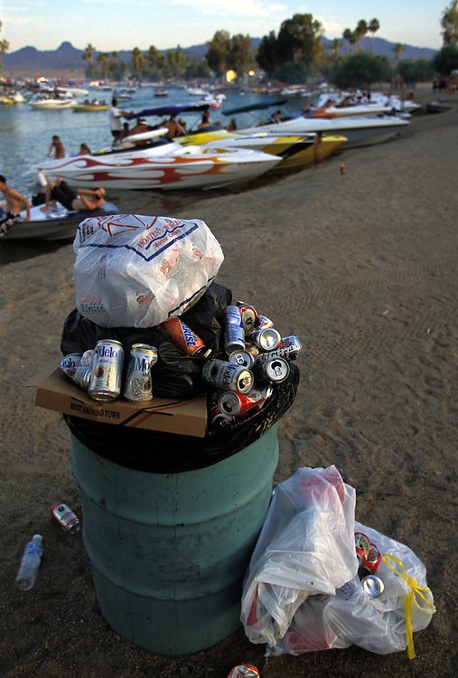 A trash can along the shoreline at Bridgewater Channel at Lake Havasu is indicative of the party atmosphere at the lake on Memorial Day weekend.