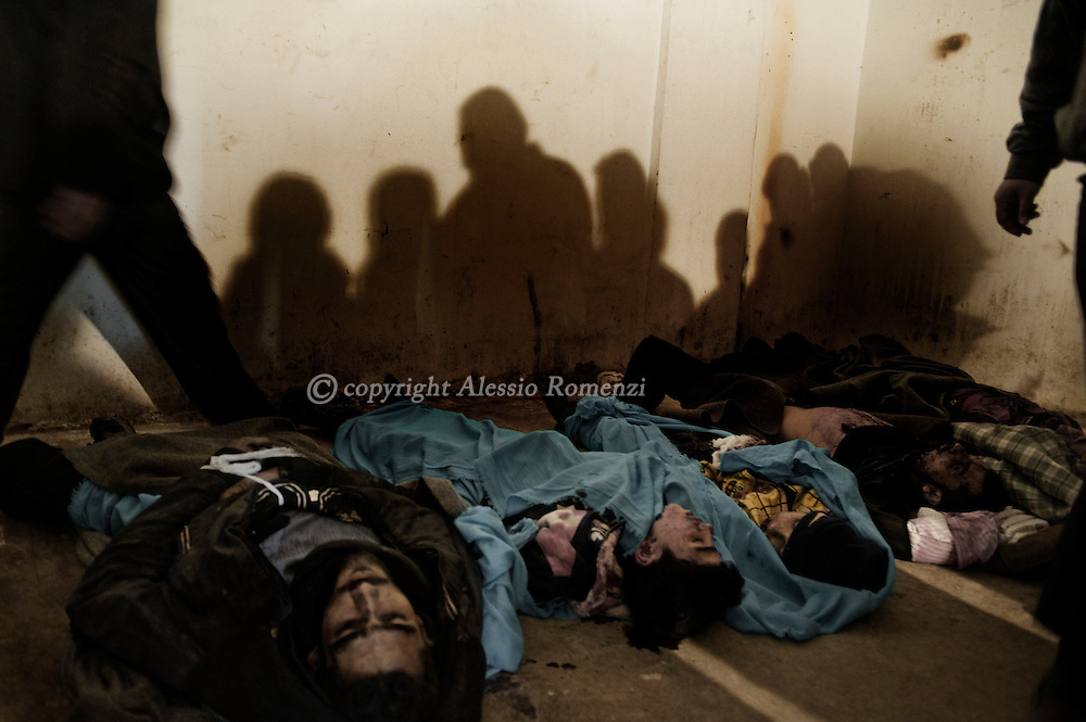 SYRIA - Homs province: Five dead bodies of civilians killed by a mortar lie on a refrigerator used by the resistance as a morgue in Homs province, among them two children, on February 20, 2012. ALESSIO ROMENZI