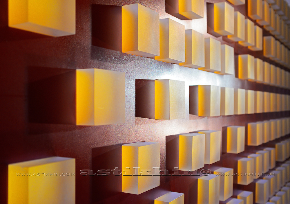 Brown background with reflecting gold cubes.