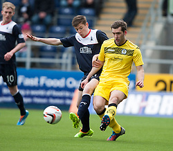 Falkirk's Conor McGrandles and Queen of the South's Michael Paton.<br /> Half time : Falkirk 0 v 0 Queen of the South, Scottish Championship game today at the Falkirk Stadium.<br /> &copy; Michael Schofield.