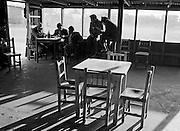 Men gather to talk and drink at the El Pescador Bar.  February, 1972.