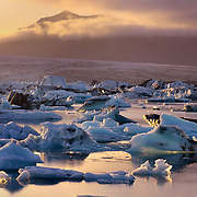 Midnight sun illuminating ice floating in Jökulsarlön, South Iceland, Europe