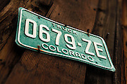 SHOT 7/12/11 11:06:03 AM - A State of Colorado license plate on an old building in Silverton, Co. The town of Silverton is a Statutory Town that is the county seat of, and the only incorporated municipality in, San Juan County, Colorado, United States.[8] Silverton is a former silver mining camp, most or all of which is now included in a federally designated National Historic Landmark District, the Silverton Historic District. The town population was 531 at U.S. Census 2000.